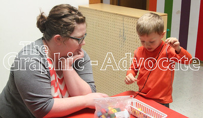 Wyatt Krause demonstrates a beading technique to Brittany Krause at The Kids Spot open house April 19. GRAPHIC-ADVOCATE PHOTO/ERIN SOMMERS