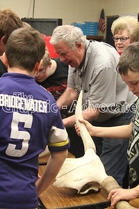 Veterinarian Dr. Paul Armbrecht shows South Central Calhoun Middle School students a specimen he brought to display during the ag career day March 29. GRAPHIC-ADVOCATE PHOTO/ERIN SOMMERS