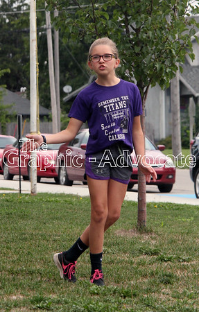 A girl steps in time with a new cheer during the SCC Titans Cheer Camp Friday morning in Lake City. GRAPHIC-ADVOCATE PHOTO/ERIN SOMMERS