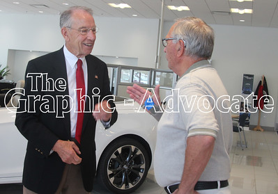 U.S. Sen. Charles Grassley meets with a constituent Aug. 16 at Macke Motors in Lake City. Grassley will be back in Calhoun County Thursday for the Calhoun County GOP family picnic in Rockwell City. GRAPHIC-ADVOCATE PHOTO/ERIN SOMMERS