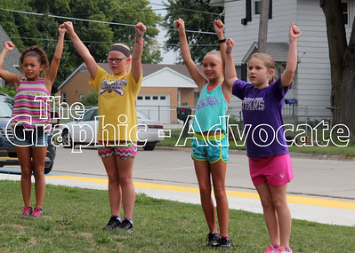 Girls practice a cheer during the SCC Titans Cheer Camp Friday morning in Lake City. GRAPHIC-ADVOCATE PHOTO/ERIN SOMMERS