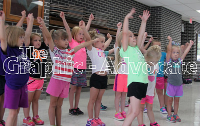 Young girls stretch while performing a cheer during the SCC Titans Cheer Camp Friday morning in Lake City. GRAPHIC-ADVOCATE PHOTO/ERIN SOMMERS