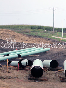 Segments of pipe are seen in a field north of Rockwell City Monday morning. GRAPHIC-ADVOCATE PHOTO/ERIN SOMMERS
