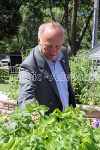 U.S. Rep. Steve King, R-4th, takes a closer look at a plant in a sensory garden at Opportunity Living in Rockwell City. King visited Calhoun County Aug. 22, speaking with constituents at Gabby's, touring the North Central Correctional Facility and then checking out the gardens before visiting the  Opportunity Living offices in Lake City. King also toured Bowie International in Lake City that afternoon. GRAPHIC-ADVOCATE PHOTO/ERIN SOMMERS