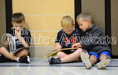 Boys read books in the South Central Calhoun Elementary School gym Thursday morning before the start of the 2016-17 school year. GRAPHIC-ADVOCATE PHOTO/ERIN SOMMERS