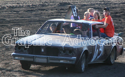 Racecar drivers gave kids rides prior to Saturday's figure 8 races. GRAPHIC-ADVOCATE PHOTO/ERIN SOMMERS