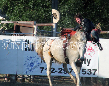 A bronco rider flies off his horse during Friday's expo rodeo. GRAPHIC-ADVOCATE PHOTO/ERIN SOMMERS