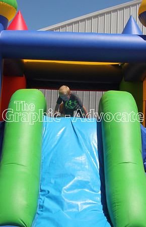 Tate Doeden, 6, jumps in a bounce house at the Calhoun County Expo Friday afternoon. GRAPHIC-ADVOCATE PHOTO/ERIN SOMMERS