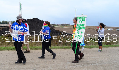 Protesters, led by Heather Pearson, left, approach a Dakota Access pipeline construction site on Preston Avenue Saturday. GRAPHIC-ADVOCATE PHOTO/ERIN SOMMERS