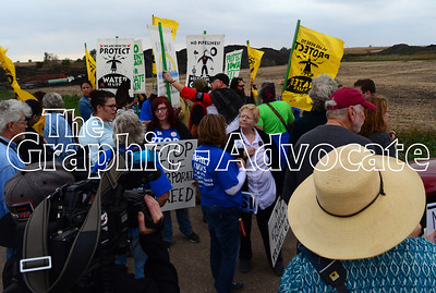 Dakota Access pipeline protesters gather on Red Oak Avenue Saturday afternoon. GRAPHIC-ADVOCATE PHOTO/ERIN SOMMERS