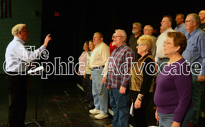 Director Jerrold Jimmerson, left, leads the Meridian Singers through a rehearsal Thursday in Manson. The group's annual performances are set for Feb. 11 and 12. GRAPHC-ADVOCATE PHOTO/ERIN SOMMERS