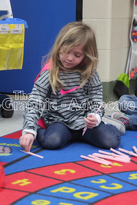Khrysta Kraft, a transitional kindergarten student at South Central Calhoun Elementary School, counts out straws during an activity Feb. 7. The district's school board will discuss the future of the TK program at its Feb. 20 meeting. GRAPHIC-ADVOCATE PHOTO/ERIN SOMMERS