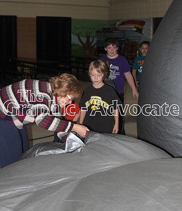 South Central Calhoun Elementary School second-grade students enter the Starlab Feb. 1. GRAPHIC-ADVOCATE PHOTO/ERIN SOMMERS