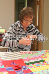 Kathy Beckman works on a quilt Jan. 23 at Pilgrim Lutheran Church in Lake City. GRAPHIC-ADVOCATE PHOTO/ERIN SOMMERS