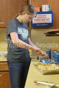 Anna McChesney prepares a chicken casserole for an Interact community service project. GRAPHIC-ADVOCATE PHOTO/ERIN SOMMERS
