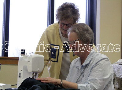 Jean Jacobson, left, and Kris Hare watch as Hare sews a piece of fabric for a quilt at Pilgrim Lutheran Church in Lake City Jan. 23. GRAPHIC-ADVOCATE PHOTO/ERIN SOMMERS