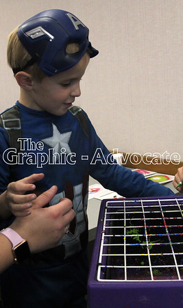 Brendan Belocock, 6, makes some spin art at the SMCH Fall Open House Thursday night. GRAPHIC-ADVOCATE PHOTO/ERIN SOMMERS