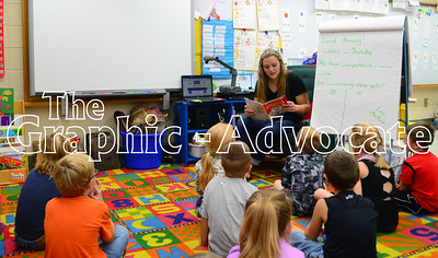 South Central Calhoun High School 2016 Homecoming Queen Kelsi Carlson reads a book to kindergarteners Thursday morning. A number of SCC high school students visited the elementary school to host a pep rally for homecoming week. GRAPHIC-ADVOCATE PHOTO/ERIN SOMMERS