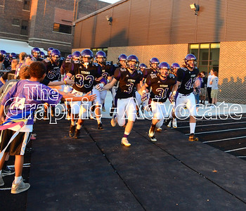 SCC football players run to the field at the start of the 2016 Homecoming game against Clarinda. GRAPHIC-ADVOCATE PHOTO/ERIN SOMMERS