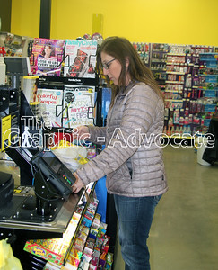 Carla Morrow of Lake City prepares to pay for her purchases Saturday at Dollar General in Lake City. The store held its grand opening Saturday. GRAPHIC-ADVOCATE PHOTO/ERIN SOMMERS