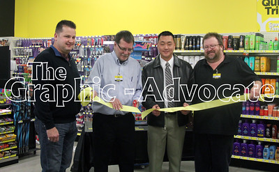 Dollar General store manager Dave Dahlstrom, second from left, cuts a ribbon during the Lake City store's grand opening Saturday. Also pictured, from left, are Lake City Councilman Gary Bellinghausen, Lake City Mayor Tyler Holm and store employee Tony Pierson. GRAPHIC-ADOVCATE PHOTO/ERIN SOMMERS