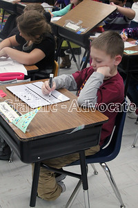 Caleb Gaffney works on a math problem in Andy Wuebker's third-grade class last month. GRAPHIC-ADVOCATE PHOTO/ERIN SOMMERS