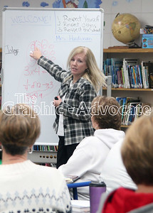 Annette Louk of the Prairie Lakes Area Education Agency works with South Central Calhoun Elementary School teachers during a December professional development day. GRAPHIC-ADVOCATE PHOTO/ERIN SOMMERS