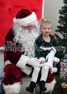 Zoey Dailey, 4, talks with Santa about what she wants for Christmas. GRAPHIC-ADVOCATE PHOTO/ERIN SOMMERS