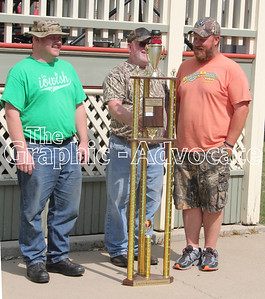 Jason Bixenstine, Paul Bixenstine and Mark Hungate accept the trophy for winning the 2017 Dell Blair Memorial Chili Cookoff at the Lake City Fall Fest Sunday. GRAPHIC-ADVOCATE PHOTO/ERIN SOMMERS