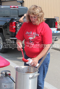 Michelle Blair dishes up a cup of chili Sunday afternoon. GRAPHIC-ADVOCATE PHOTO/ERIN SOMMERS