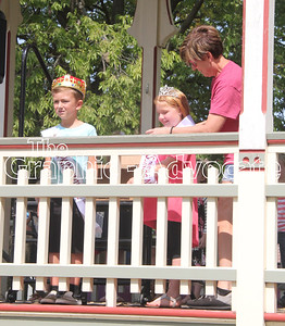 Lynn Poen, right, crowns Jasey Watters the 2017 Lake City Fall Fest Little Princess Sunday afternoon, while Little Prince Deagan Dusenberry, at left, looks out at the crowd from the bandstand. GRAPHIC-ADVOCATE PHOTO/ERIN SOMMERS