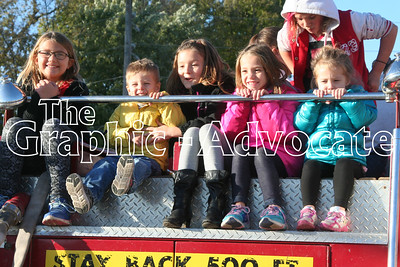 Children take a ride on a Lake City fire truck Thursday afternoon. GRAPHIC-ADVOCATE PHOTO/JERI WILSON
