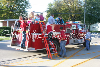 Children sit on top of a Lake City fire truck during Thursday's open house. GRAPHIC-ADVOCATE PHOTO/JERI WILSON