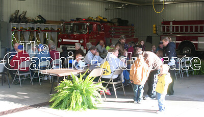 Lake City community members enjoy a meal in the Lake City Fire Department Thursday evening, as part of the department's annual open house. GRAPHIC-ADVOCATE PHOTO/JERI WILSON