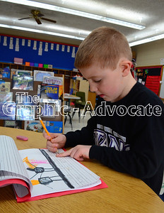 Noah Blair writes sentences in his journal in Kris Nicholson's kindergarten class Feb. 21. The South Central Calhoun school board denied a request from the elementary school principal to eliminate the transitional kindergarten program for next year. Had the plan been approved, all 5-year-old students would have entered kindergarten in the fall. GRAPHIC-ADVOCATE PHOTO/ERIN SOMMERS