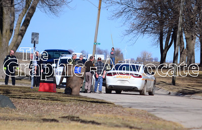 Law enforcement officers place Paul Goodman into a vehicle after arresting him Tuesday morning on Grant Street in Rockwell City. GRAPHIC-ADVOCATE PHOTO/ERIN SOMMERS