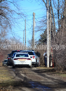 Law enforcement vehicles are seen lined up in an alley parallel to Grant Street Feb. 21. Officers asked Paul Goodman to leave his Grant Street home the night before, and Goodman refused, officers said. He was arrested without incident midday Tuesday. GRAPHIC-ADVOCATE PHOTO/ERIN SOMMERS