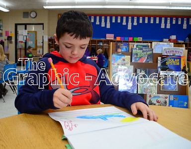 Kindergarten student Joe Sewick writes in his journal Feb. 21. GRAPHIC-ADVOCATE PHOTO/ERIN SOMMERS
