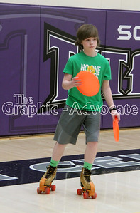 Jamie Schoonover prepares to throw two Frisbees while rollerskating during gym class March 6 at South Central Calhoun Middle School. GRAPHIC-ADVOCATE PHOTO/ERIN SOMMERS