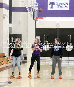 Karlee Cornelius, Kortney Riley and Emma Geno rollerskate during gym class March 6. GRAPHIC-ADVOCATE PHOTO/ERIN SOMMERS