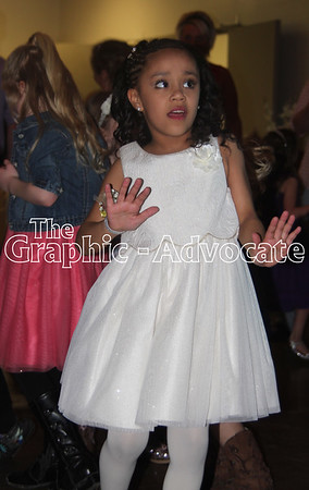 Kinley Walker dances at the Boots and Belles Father/Daughter Dance Saturday night in Rockwell City. Nearly 200 girls and their dads, grandfathers and relatives attended the dance. GRAPHIC-ADVOCATE PHOTO/ERIN SOMMERS