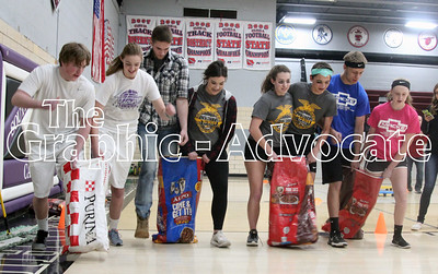 After being rescheduled several times because of school cancellations, the South Central Calhoun High School FFA was able to hold its Ag Olympics Thursday afternoon. Here, particpants run a three-legged sack race. GRAPHIC-ADVOCATE PHOTO/ERIN SOMMERS