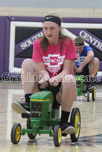 Jessica Hicks leads Tanner Macke in a pedal car race during the FFA Ag Olympics Thursday at South Central Calhoun High School. GRAPHIC-ADVOCATE PHOTO/ERIN SOMMERS