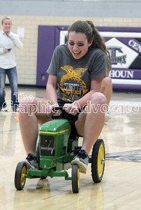 Tiffany Poen rides a pedal car during a race for the FFA Ag Olympics Thursday at South Central Calhoun High School. GRAPHIC-ADVOCATE PHOTO/ERIN SOMMERS