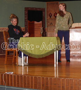 """Sydney Batz, left, and Kjersti Olson, right, rehearse a scene from """"Trouble in Tumbleweed,"""" which South Central Calhoun High School Drama Department will present Friday and Saturday night. GRAPHIC-ADVOCATE PHOTO/ERIN SOMMERS"""