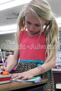 Iris Melody works on a story at South Central Calhoun Elementary School Tuesday afternoon. The school released its Iowa Assessment scores last week, noting significant improvements in several areas. GRAPHIC-ADVOCATE PHOTO/ERIN SOMMERS