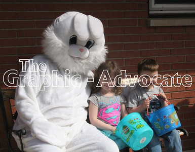 Korbin VanHorn and Willow King sit with the Easter Bunny at Sunny Knoll Care Center in Rockwell City Friday afternoon. GRAPHIC-ADVOCATE PHOTO/ERIN SOMMERS
