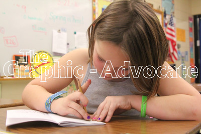 Sophia Wuebker edits a story she is writing in Kari Case's second-grade class at South Central Calhoun Elementary School. The school's students posted good scores on the Iowa Assessment tests, school officials said last week. GRAPHIC-ADVOCATE PHOTO/ERIN SOMMERS
