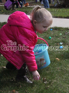 A girl picks up Easter eggs during a hunt at Sunny Knoll Care Center in Rockwell City Friday afternoon. GRAPHIC-ADVOCATE PHOTO/ERIN SOMMERS