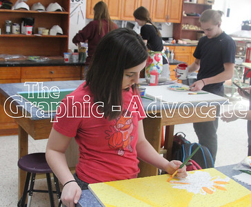 Maddie Neal works on a sunshine and flower painting on a ceiling tile for Stewart Memorial Community Hospital Feb. 27. GRAPHIC-ADVOCATE PHOTO/ERIN SOMMERS